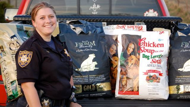 Deputy Sheriff Nina Lee from the Gwinnett County Jail Dog Program receives a donation of holistic dog food as part of Desperate Dogs volunteer work its does with this wonderful program