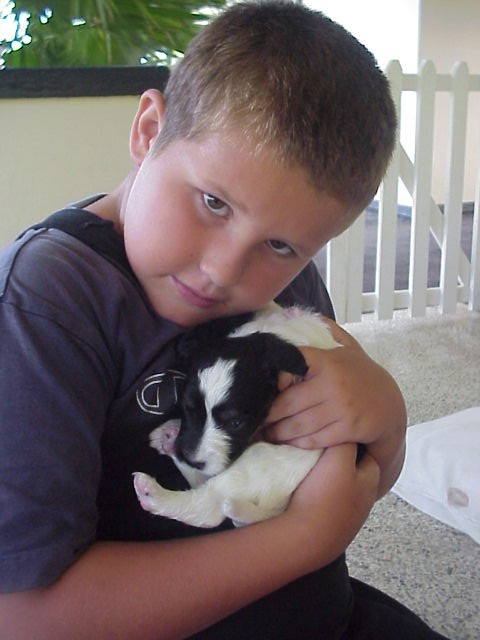 Jake our youngest son (and much younger here!!) cuddles his first rescue dog, Wishbone, during our time in Trinidad & Tobago